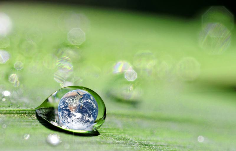 earth inside a water drop on a leaf