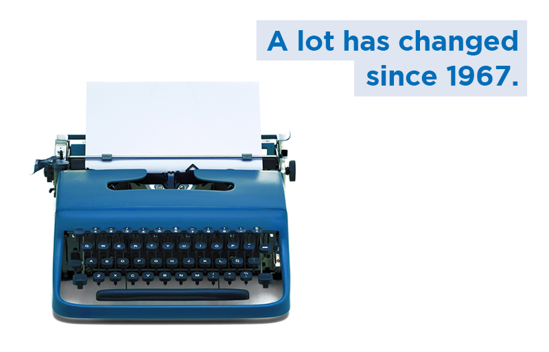 "Old-fashioned blue typewriter on white background, with caption ""A lot has changed since 1967."""