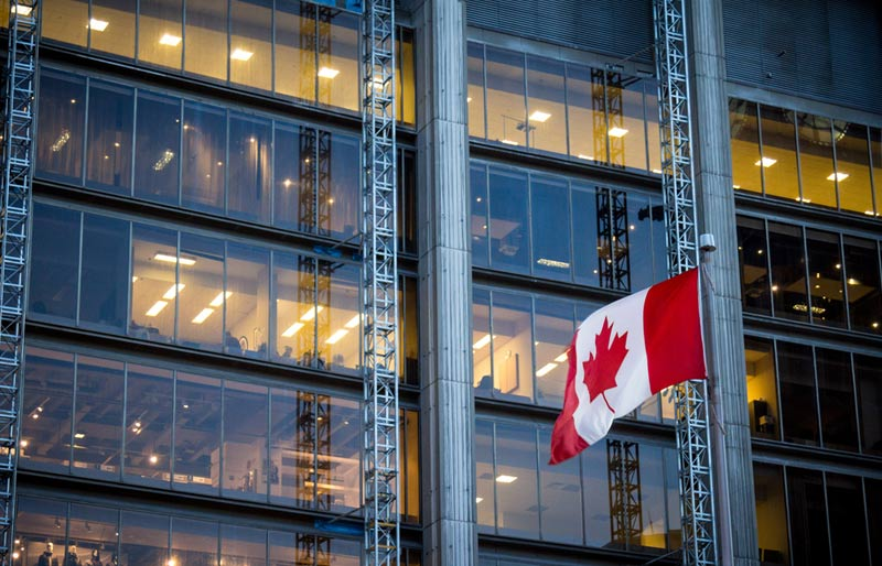 finance Canada consultation, Canada flag in front of business