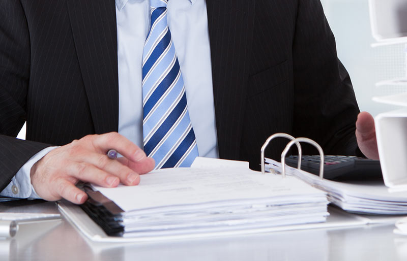 A close-up of a business professional reviewing a report.