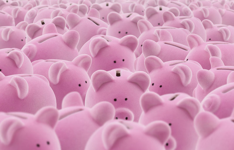 Pile of pink piggy banks sitting side-by-side