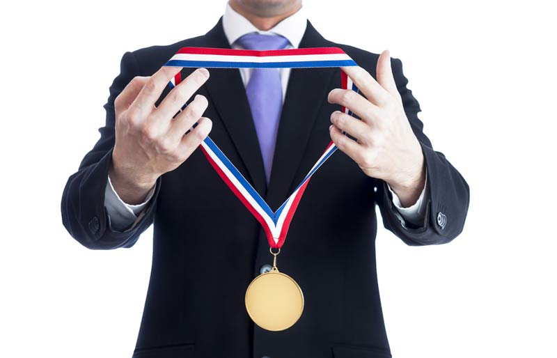 Accounting Business Professional holding a medal award.